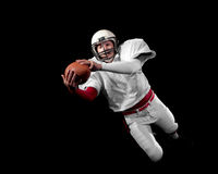 American football player. Studio shot over black Royalty Free Stock Images