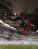 The american football player in action. In stadium Stock Images