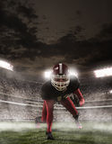 The american football player in action. In stadium Royalty Free Stock Photo