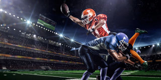 American football player in action on stadium royalty free stock photo