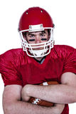 American football player with arms crossed Stock Photo
