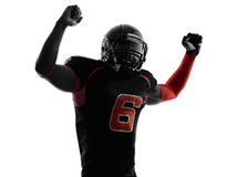 American football player arms raised  portrait silhouette. One american football player arms raised portrait in silhouette shadow on white background Stock Photography