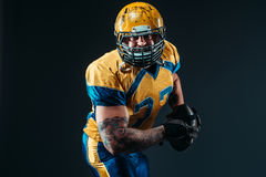 American football player, ball in hands, NFL Royalty Free Stock Images