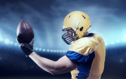 American football player with ball on sport arena Stock Image