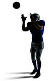 American football player catching ball Stock Image