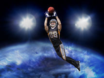 American football player catching ball Royalty Free Stock Photo