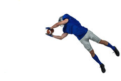 American football player catching ball in mid-air Stock Images