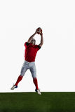American football player catching football Royalty Free Stock Photos