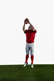 American football player catching football Stock Image