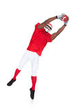 American Football Player Catching Rugby Ball Royalty Free Stock Photography