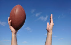 American Football Player Celebrates a Touchdown. Holding a American Football and Giving the Touchdown Sign Royalty Free Stock Images