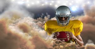 American football player in clouds. Digital composite of american football player in clouds Royalty Free Stock Images