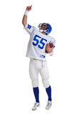 American football player cut out. Photo of an American football player, cut out on a white background Stock Photo