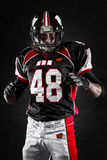 American football player on dark background Stock Image