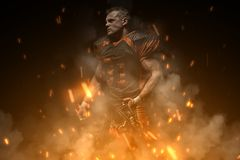 American football player on dark background in smoke and sparks in black and orange outfit
