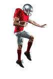 American football player defending. Full length of American football player defending against white background stock photos
