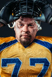 American football player face, helmet on the head Royalty Free Stock Image