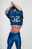 American football player. Good-looking model in american football uniform Royalty Free Stock Photo