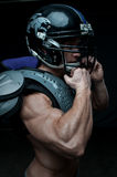 American football player. Good-looking model in american football uniform Stock Photos