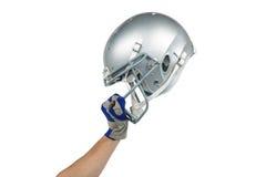 American football player handing his helmet Stock Photo