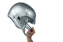 American football player handing his sliver helmet. Cropped image of American football player handing his sliver helmet on white background Royalty Free Stock Photo