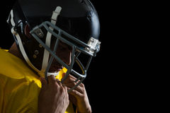American football player with a head gear stock photography