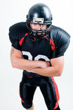 American football player in helmet. Studio isolated Royalty Free Stock Image