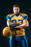 American football player with helmet in hand Stock Photography
