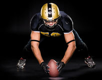 American football player holding ball Royalty Free Stock Photography