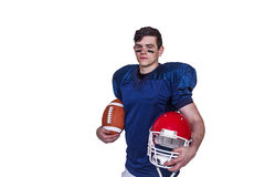 American football player holding a ball and helmet Royalty Free Stock Images