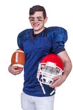 American football player holding a ball and helmet Royalty Free Stock Photos