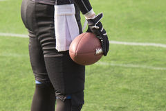 American football player holding a ball Royalty Free Stock Photo