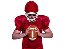 American football player holding a ball Stock Image