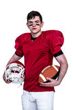 American football player holding helmet and a ball Stock Photo
