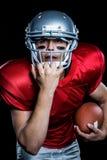 American football player holding helmet Stock Photo