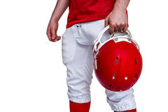American football player holding a helmet Royalty Free Stock Images
