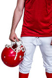 American football player holding a helmet Stock Photography