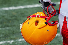 American football player holding his helmet royalty free stock photography