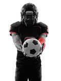 American football player holding soccer ball  silhouette Stock Photography