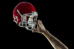 American football player holding up his helmet Stock Images