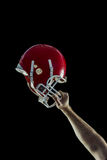 American football player holding up his helmet Stock Photo