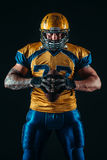 American football player holds ball in hands Stock Photo