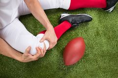 American football player with injury in leg Royalty Free Stock Images