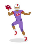 American Football Player in Jumping with Ball Stock Images
