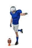 American football player kicking ball Stock Images