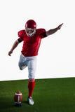 American football player kicking football Royalty Free Stock Photo