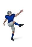 American football player kicking Stock Photo