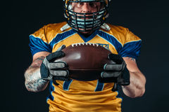 American football player with laced ball in hands Royalty Free Stock Photography