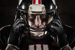 American football player looking at camera. Portrait of american football player looking at camera with intense gaze Royalty Free Stock Photos