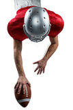 American football player lying in front with ball Royalty Free Stock Photo
